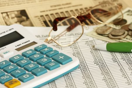 Close up of a calculator financial figures and pen.  Stock Photo - 5869410