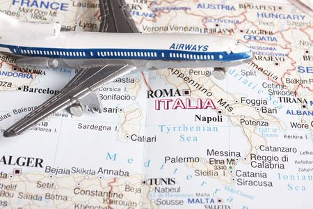 Flight to Italy concept - with toy plane and europe map. photo