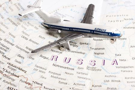 metaphoric: Travel to Moscow concept - with toy plane in russian map.