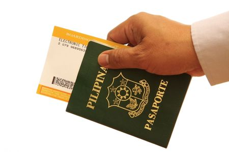 Hand with passport isolated on white background photo