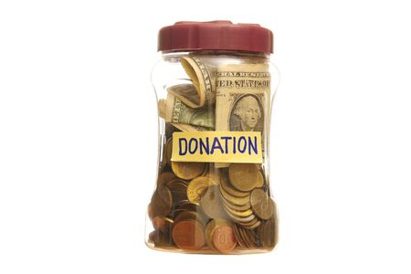 frugality: Donation in a closed Jar over a white background.