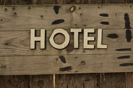 A western style hotel sign on wooden panel photo