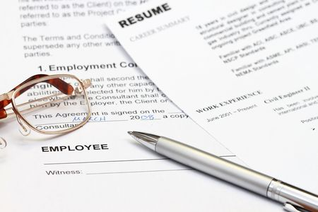 close up of resume form with employment contract ready to sign. Stock Photo - 5993871