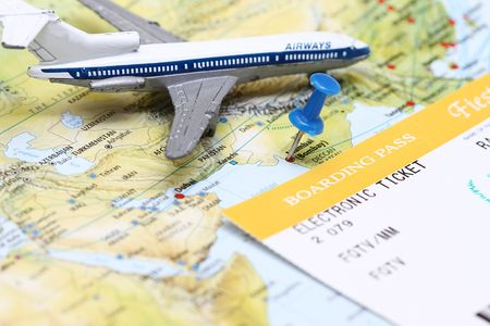 metaphoric: Travel conceptual - a plane flying over India map with boarding pass.