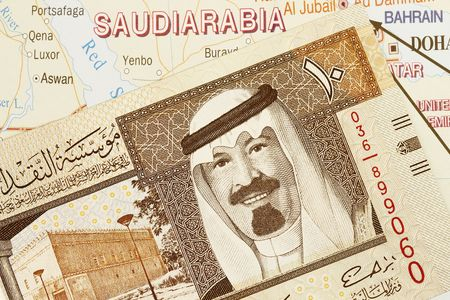 arabic currency: Close up shot of Saudi Arabia money and map. Stock Photo