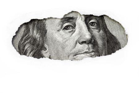Benjamin Franklin macro peeking through torn white paper. Stock Photo - 6071918