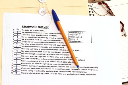 manila envelop: Teamwork survey concept - with points on every answer.