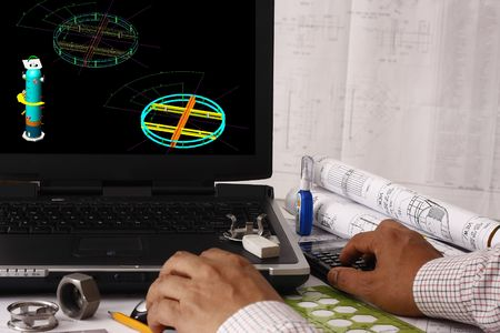 construction draftsman: Engineer doing a model review in his design - many uses in oil & gas industry.