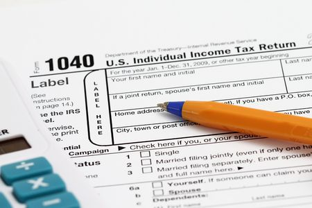 financial official: completing a 1040 tax form with calculator.
