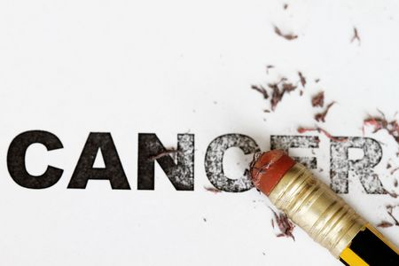 eradicate: Eradicate remove cancer concept as eraser erase the word cancel. Stock Photo