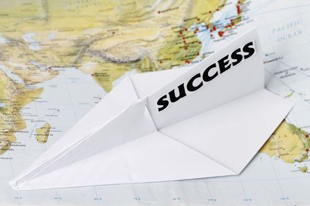 Paper Plane with Success in a world map. Stock Photo - 6439546