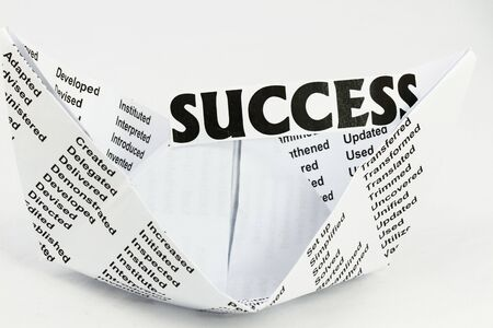 developement: Success inside a origami with successful words all over.