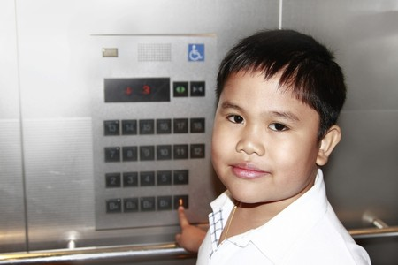 Portrait of asian boy inside an elevator. photo