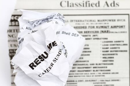 resume: Resume crumpled up and tossed in frustration.