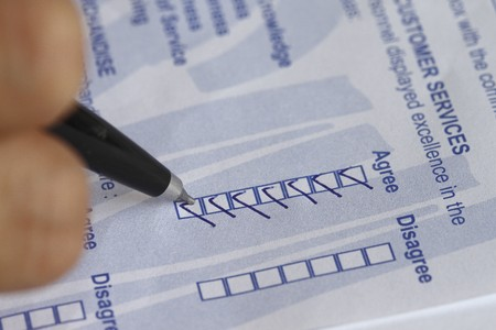Filling out a customer service survey form. Stock Photo - 7393363