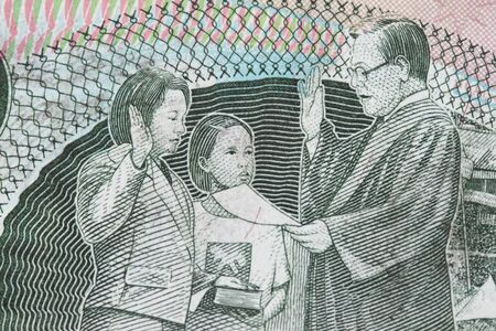 arroyo: Close-up  of 200 peso with president Arroyo of The Philippines taking oath.