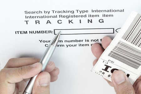 Tracking the item with barcode and pen. photo