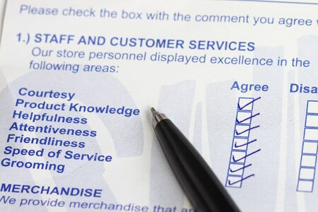 Business values - satisfied customers concept with a survey form  photo