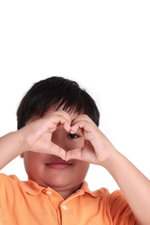 Boys hands making heart shape isolated in white background photo