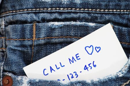 Call me note in a blue jeans pocket  photo