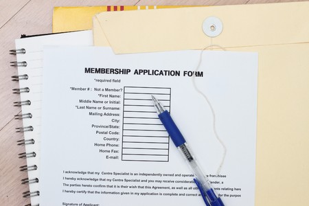 surname: Membership application form with envelopes and spiral notebook Stock Photo