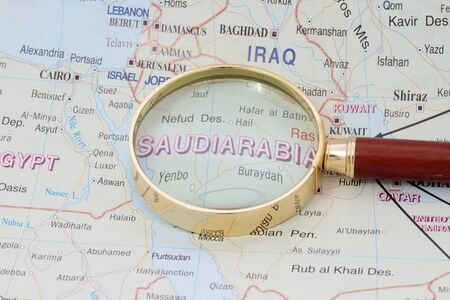 Map of Saudi Arabia with magnifying glass photo