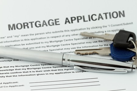repossession: Mortgage Application with pen and key in a mortgage form Stock Photo