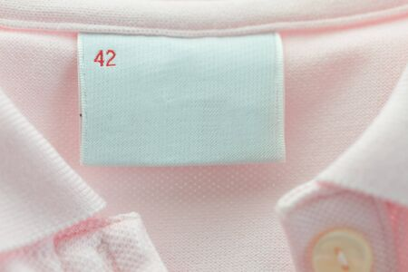 Blank label of a pink clothing with 42 size photo