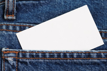 Blue jeans detail with blank badge - put your text on the white card Stock Photo - 7886357