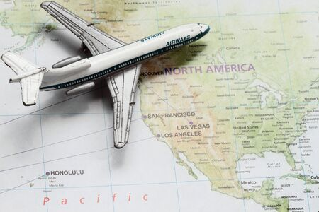 Travel concept with toy airplane on the continental USA photo