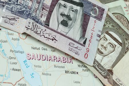 All about saudi arabia with map and bank notes photo