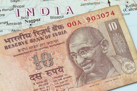 Indian currency - Indian rupees against the map background photo