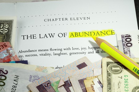 Law of abundance concept - with many denominations of currency Stock Photo - 7886403