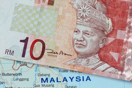 Malaysian currency  with map  of malaysia background photo