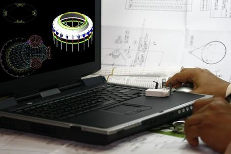 Engineer looking through his 3d modelling works