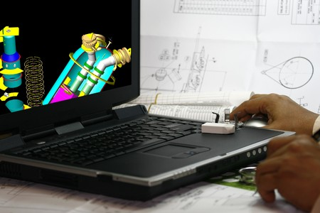 Engineer looking through his 3d modelling works photo