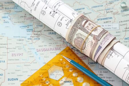 saudi arabia: Blueprint and roll of riyal in saudi arabia map - many uses in the oil and gas industry.