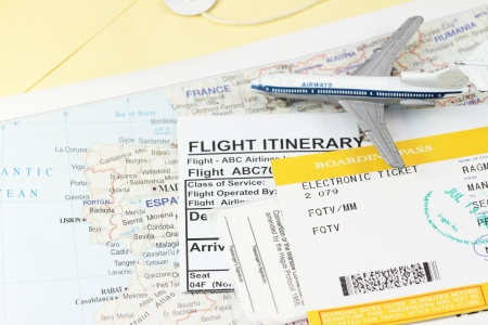 Flight itinerary with toy airplane and map abstract photo