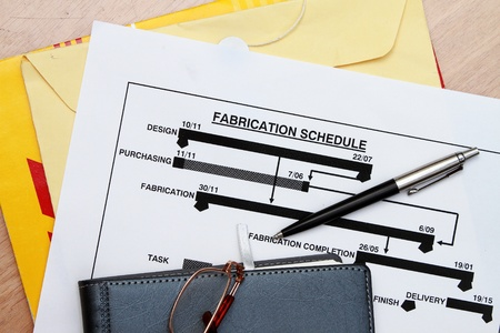 Project plan and manufacturing schedule with business diary photo