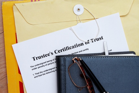 Trust certificate abstract- with diary and manila envelop Stock Photo