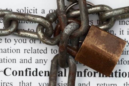 lock and chain in confidential agreement document background photo