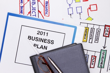 Documents workflow with graphs and business plan photo