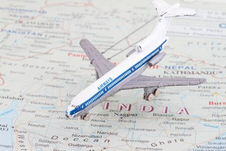 Toy Airplane on map of India. Shallow depth of field from use of macro lens  photo