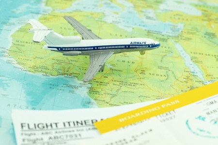Travel and flight concept with boarding pass and flight itinerary