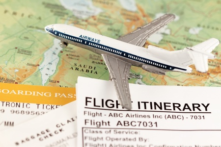 Travel concept to middle east - with flight itinerary, boarding pass and baggage claim photo