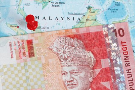 Malaysian ringgit currency macro shot with malaysian map background photo