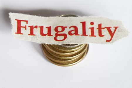 frugality: Frugality concept - with coins in white backround