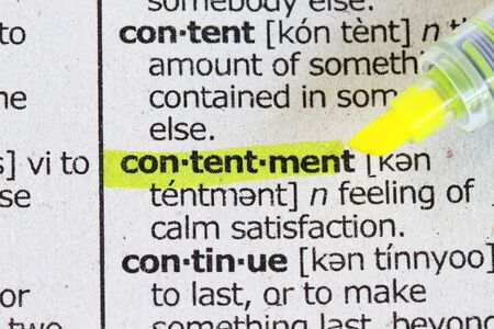 Contentment in dictionary- macro shot with highlighter