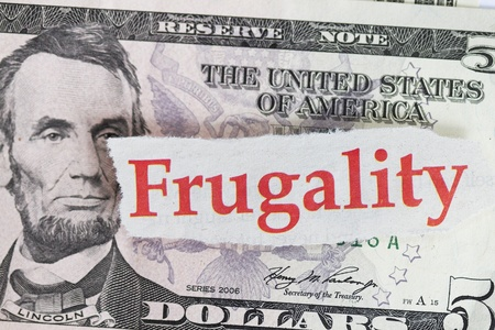 frugality: Frugality abstract on five dollar close up shot. Stock Photo