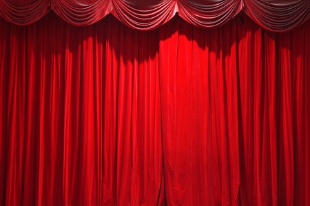 red closed curtain of a classical theater